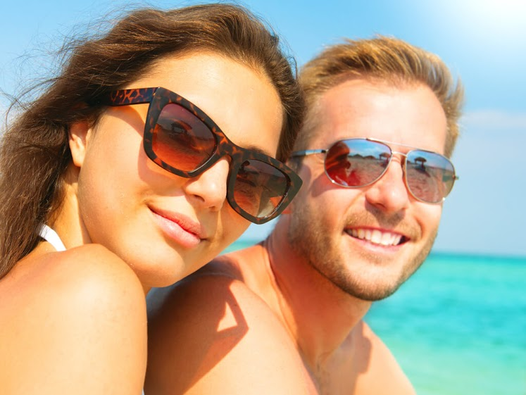 bigstock-Happy-Couple-in-Sunglasses-hav-90264746